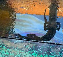 Reflection in a diesel spill by M. van Oostrum