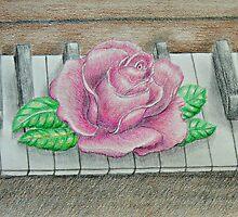 pink rose on piano by thuraya o