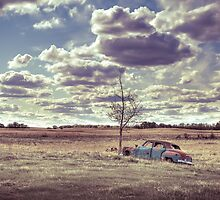 Antique car in rural landcape by RainaRaina