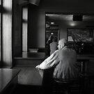 Man  in Hotel by Andrew  Makowiecki