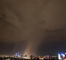 Dramatic rain storm cloud at night over Sydney city, Australia by Sharpeyeimages