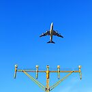 Plane fly up over take-off runway from airport at daytime by kawing921