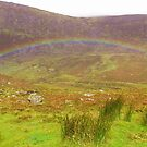 Rainbow over the Comeragh Mountains Ireland by ragsers
