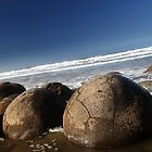 Moeraki boulders by Kyra  Webb
