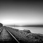 Dawn, cool, train coming down the tracks by matt1960