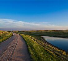 Lonely gravel road by Jonathon Vasquez