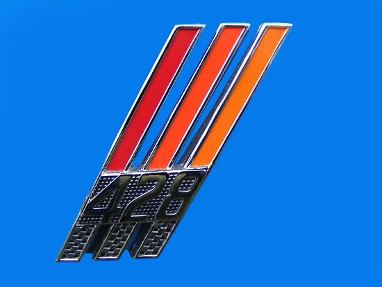 428 Badge  by Russell Voigt