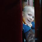 Noah and then his reflection on the sill of the train car. by Penny Rinker