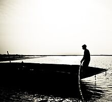 Rowing a traditional boat by zaghumkhan