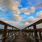 The Wood bridge in blue sky by arthit somsakul