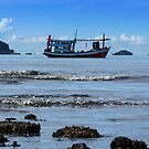 Fisheeman boat in sea by arthit somsakul