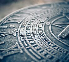 sun dial by Karm Photography