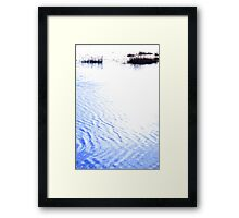 calm rippled water surface with rushes at sunset Framed Print