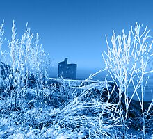 christmas season view of ballybunion castle and beach in blue snow by morrbyte