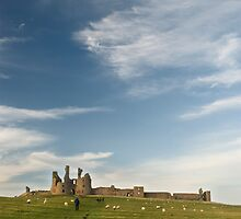 Dunstanburgh castle and sky  by StephenRB