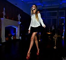 Nina tiptoed across the room in silence, so as not to wake the dead. by MarcW