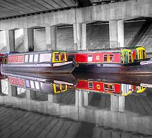 Canal barges under the bridge by Paul Madden
