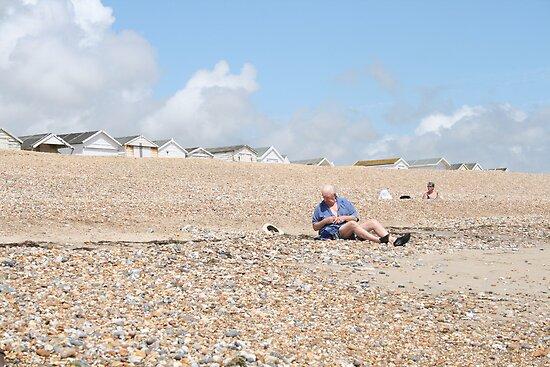 Man on beach by liptonmania