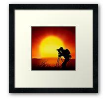 shooting the sun Framed Print