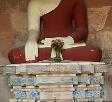 Monk praying to Buddha statue in Bagan by TravelShots
