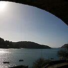 View through arch across Salcombe estuary, Devon, UK by silverportpics