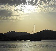 Sailboat anchored at Sunset  by SlavicaB