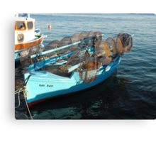 Greek small fishing boat and nets Canvas Print