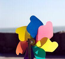 Colourful toy beach windmill, Salcombe, Devon, UK by silverportpics
