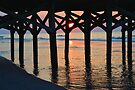 Peeking Sun Under The Pier by Dawne Dunton