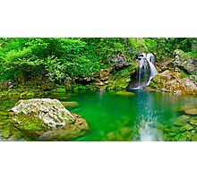 Beatiful waterfall falling into peaceful river Photographic Print