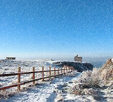 fenced walk to ballybunion castle in blizzard by morrbyte