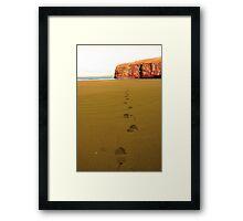 footprints in sandy empty beach on a beautiful winters day Framed Print