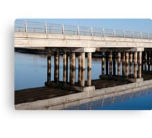 road bridge over cold river reflected Canvas Print