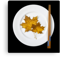 Plate with chopsticks and maple leaves Canvas Print