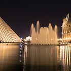 Louvre and fountain at night in Paris  by hpostant
