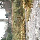 Glendalough Round Tower with river by Desaster