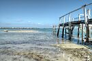 Low tides at the old pier in Montagu Beach - Nassau, The Bahamas by 242Digital