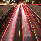 cars driving in the night up the tunnel  by hpostant