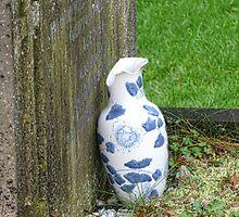 Damaged Vase At Uplyme Churchyard by lynn carter