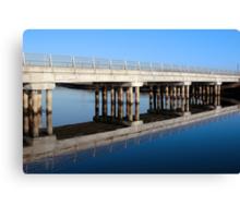 cashen road bridge over cold blue river reflected Canvas Print