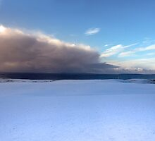 coastal snow covered links golf course in storm by morrbyte