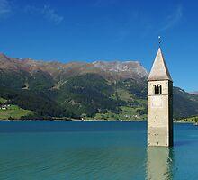 Tower of sunken church in Lago di Resia, Italy by Claudio Del Luongo