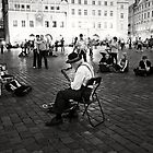 A lonely musician playing jazz on the main square in Prague  by Pavel Gospodinov