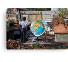 After leaving his earth sculpture in the garden overnight, Wes finds undisputed evidence of global worming. Canvas Print