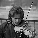 Street musician in Paris. by naranzaria