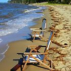 Deck chairs at the edge  by Debra Kurs