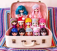 A vintage suitcase of Blythes by Zoe Power