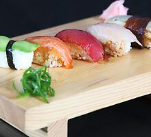 An assortment of various types of sushi  by PhotoStock-Isra