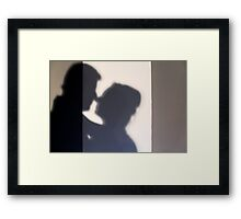 Silhouette of a kissing couple  Framed Print