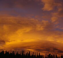 Powerful evening clouds and colors, Rocky Mountains by Claudio Del Luongo